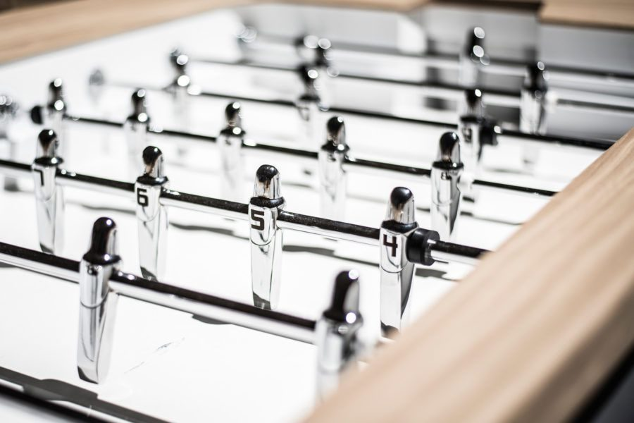 Players of design foosball table The Pure